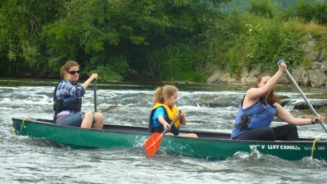 Girl power canoeing the rapids on the Wye