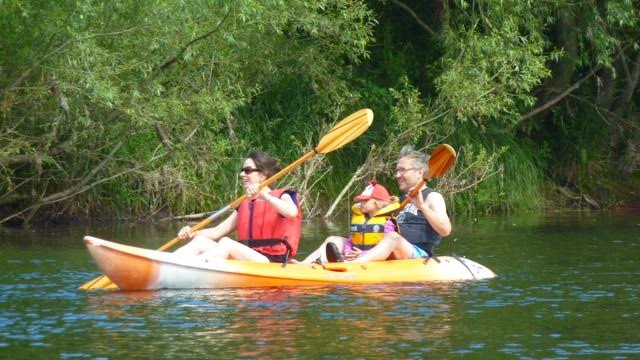 Many guests canoe from Glasbury to Hay. There is a 2 year old enjoying the trip with her father