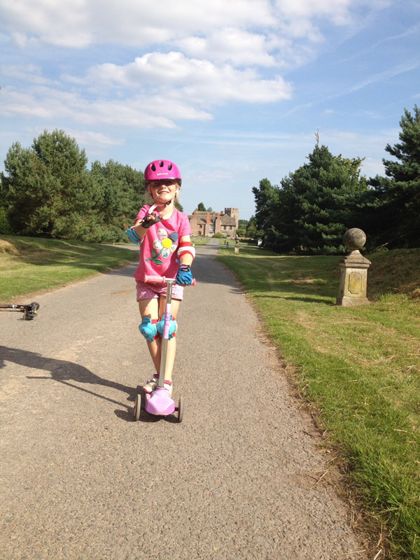 On my scooter on the Walk. Many children learn to ride their bikes here