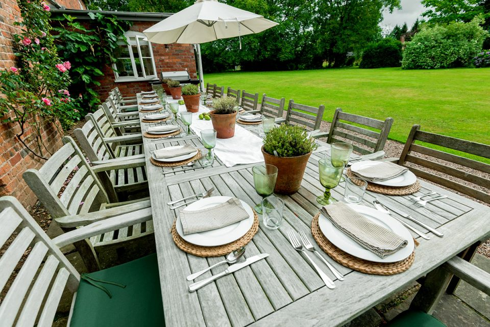 Stylish outdoor dining on the south facing terrace which is a suntrap
