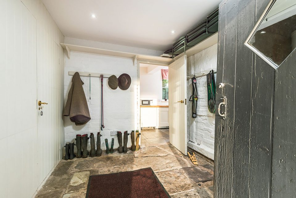 Space for coats, wellies, dod, dog leads and sports equipment in boot room
