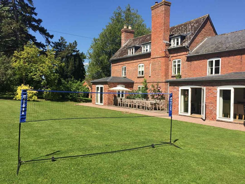 Badminton on the lawn in the huge garden