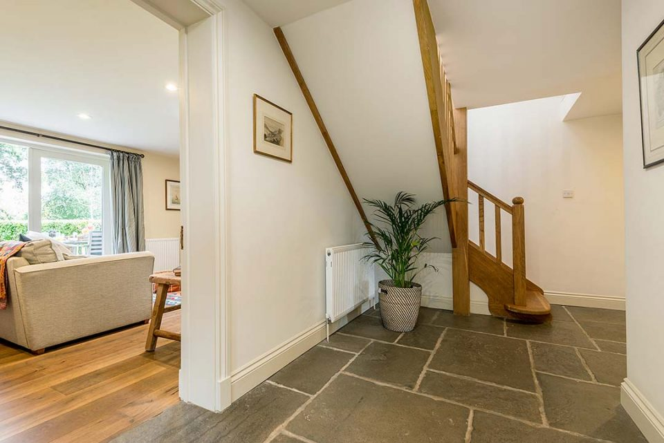 Spacious hall in the cottage with lovely oak staircase