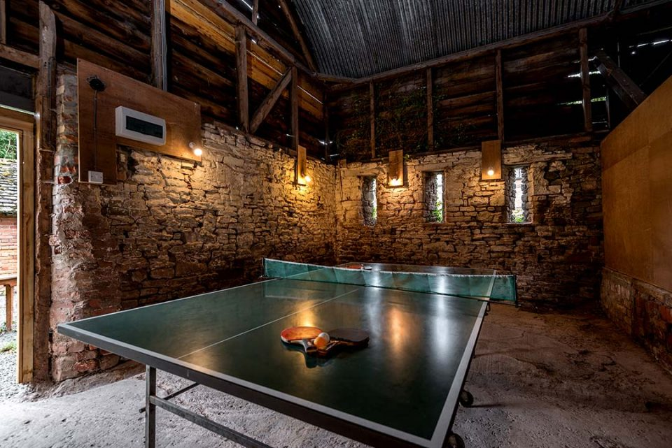 Rustic table tennis room in the outbuildings