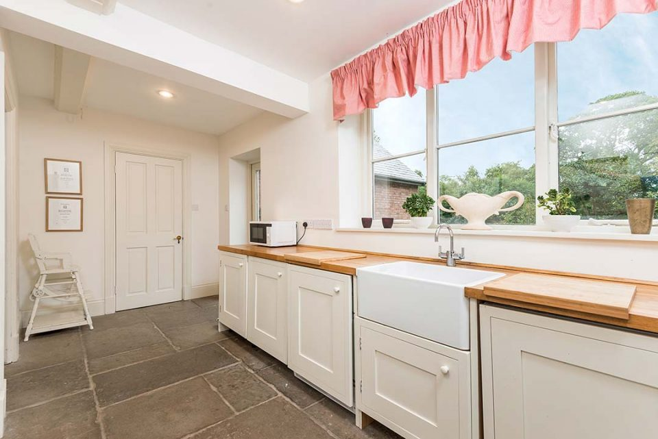 The laundry room with traditional larder cupboard and overflow fridge/freezer