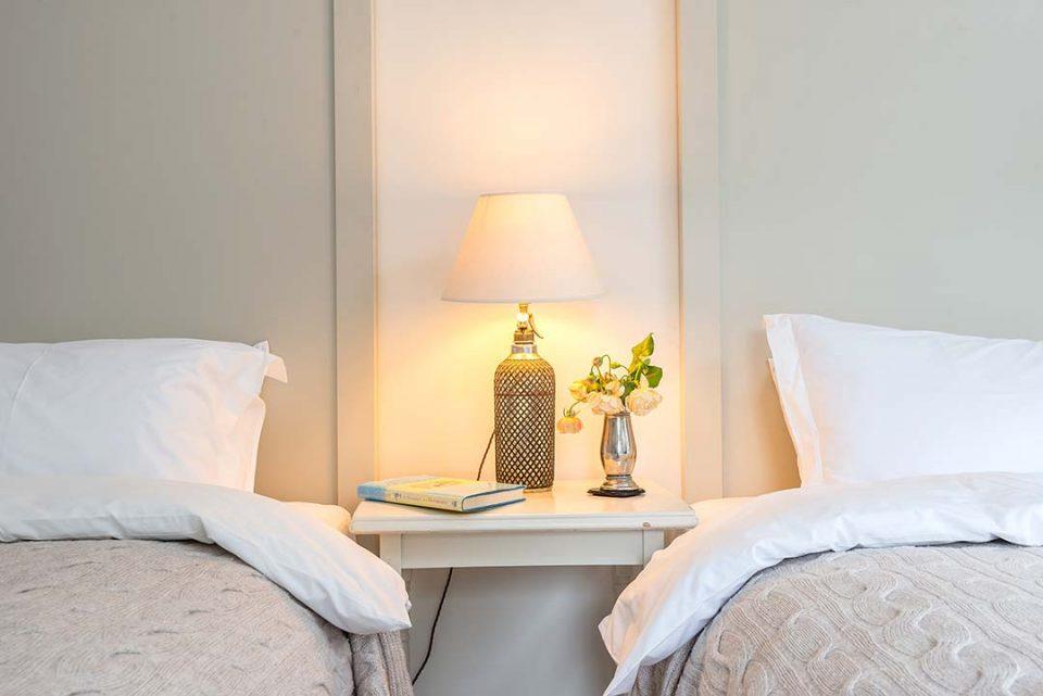 Soda syphon lamp next to roses in Tatiana bedroom