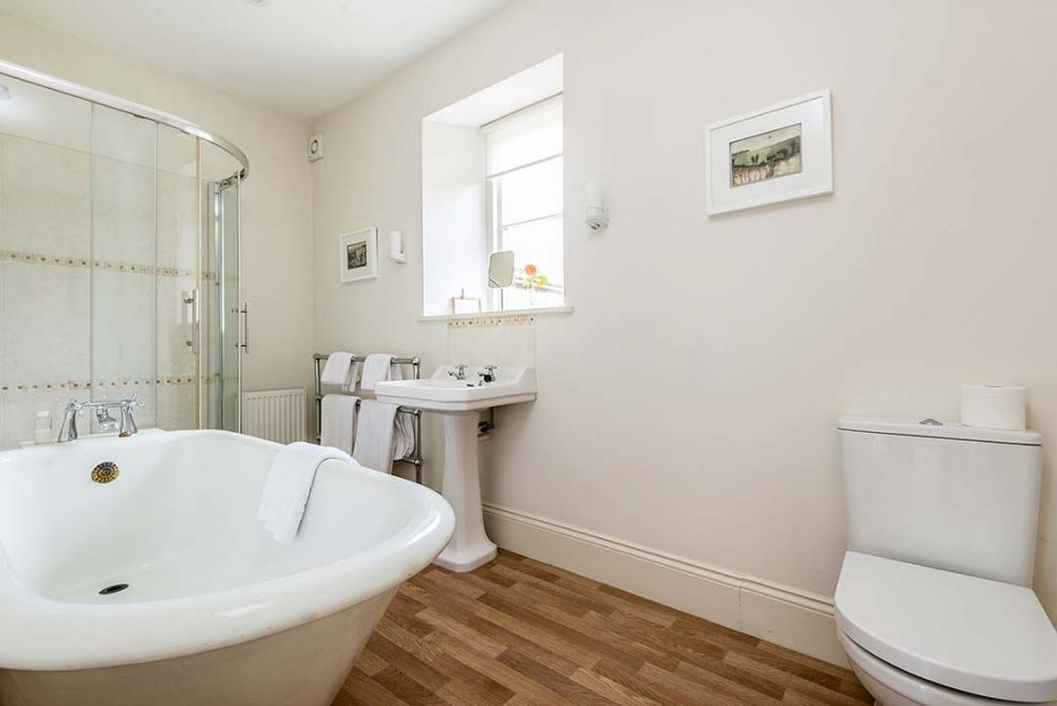 The original roll top bath in the en suite bathroom to Tatiana bedroom in the house