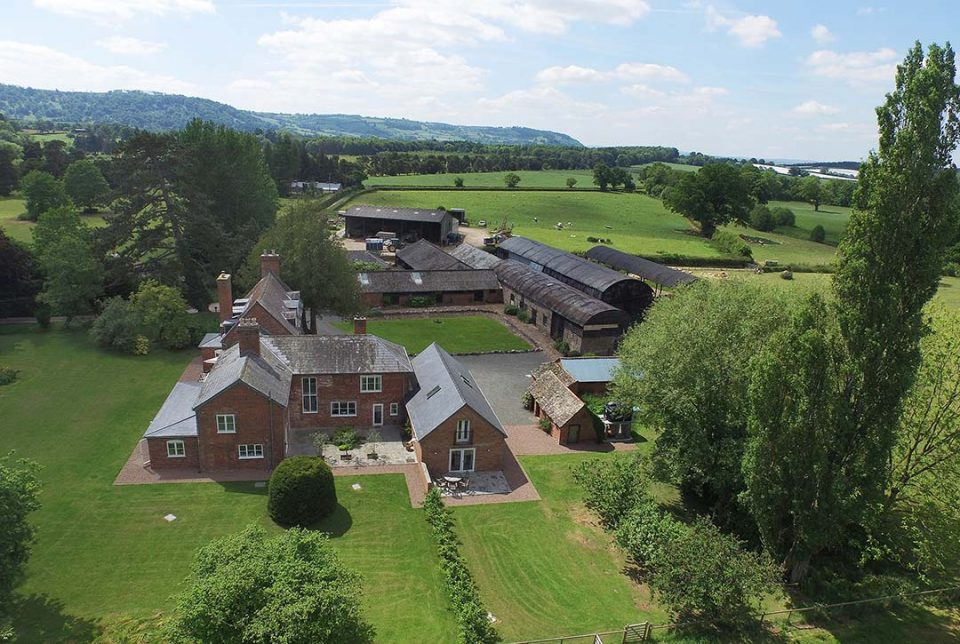 Overview of Monnington House and cottage, huge 2 acre garden, parking area and outbuildings with Wye Valley in distance